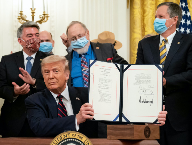 Behind Trump from left, Sen. Gardner of Colorado who lost re-election, Rep. Young the anti-environment Republican from Alaska, and Sen. Daines of Montana who won re-election. Aug 4, 2020. Click to enlarge